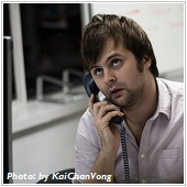 Description: man on the phone with surprising face